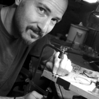 Chris Lann at work in his jewelry studio