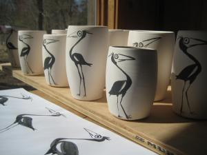 Porcelain bird vases with a few practice sheets